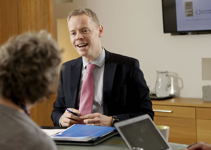 Image of Malcolm Steel in a meeting